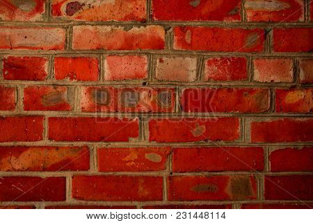 Brick Wall Red Saturated Color On The Street. Bright Aged Background In The Form Of Rectangular Bric