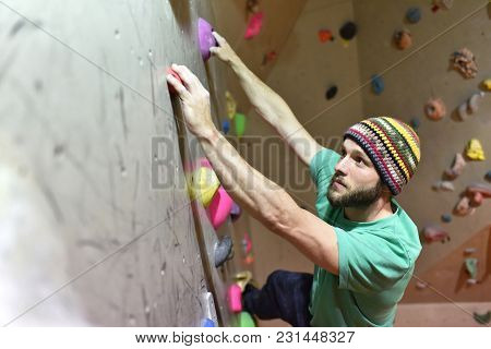Young Sporty Man Bouldering In A Climbing Hall - Indoor Sports