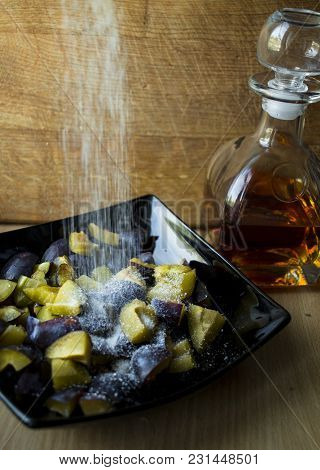 Dynamic Photo Of Plums In Sugar And Rum
