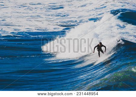 Sydney, Australia - July 4th, 2013: Surfers Riding Big Waves In Bondi Beach In Sydney During The Aus