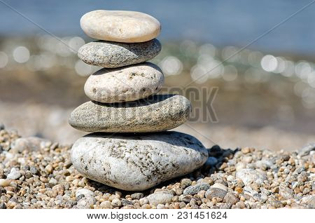 Beautiful Pyramid Of Colorful Pebbles . Rock Zen In The Background Of The Sea. Concept Of Harmony An
