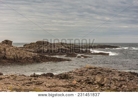 Cove, Scotland - June 9, 2012: End-of-road Lookout Over Atlantic Ocean Showing Brown Rock Formation