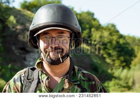 A Soldier In Military Uniform With Fighting Bullets Instead Of Teeth.