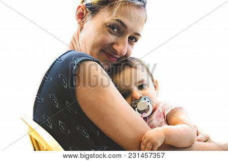 Newborn Hug Mom Before Sleep - Woman Smile Mother Cuddling Her Innocent Baby Girl With Pacifier
