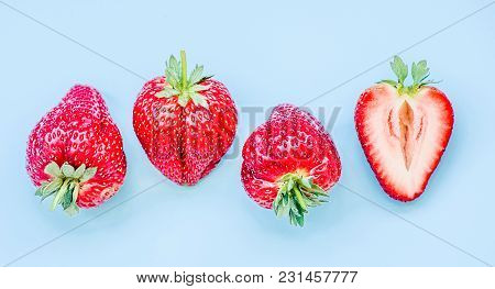 Set Of Strawberries In A Raw On Blue Background