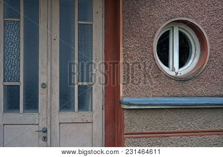 Beige Facade With Old Door And A Rounded Window
