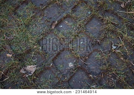 Big Wheel Tracks Imprint On The Soil .