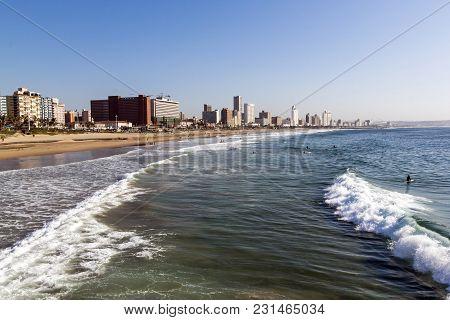Coastal Shoreline Against Blue Durban City Skyline