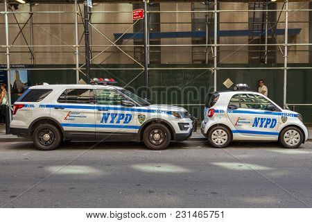Police Nypd Smart Car And Ford - Traffic Suv On The Manhattan Street.