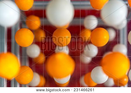 Orange And White Balls Floating In Perspective View