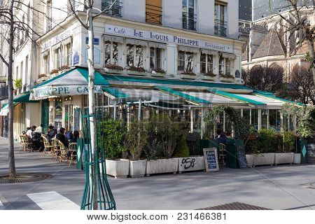 Paris, France-march 11 , 2018: The Cafe Louis Philippe Situated In A Busy Corner Of The Marais, Just