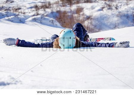 Photo Of Sporty Woman With Snowboard Lying On Snowy Slope During Day
