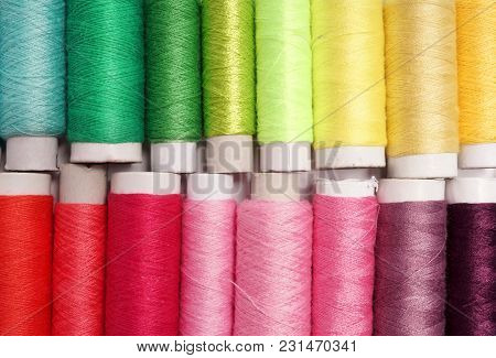 Colored sewing thread. Rainbow