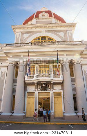 Cienfuegos, Cuba - December 7, 2017: Cienfuegos Municipal Palace And Cuban People