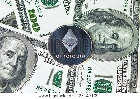Ethereum And Callisto Coins On Dollar Background. Cryptocurrency Eth Clo.