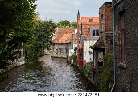 European Medieval Street On The Water Canal In The Town Of Bruges.