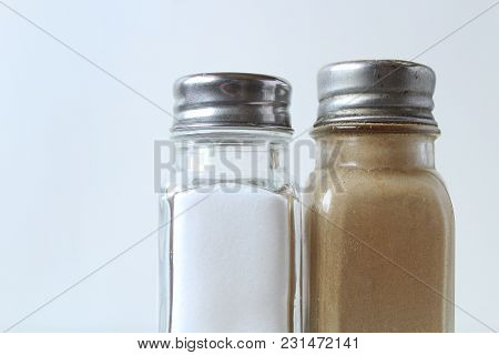 Salt And Pepper Shaker Against White Background. Copy Space.