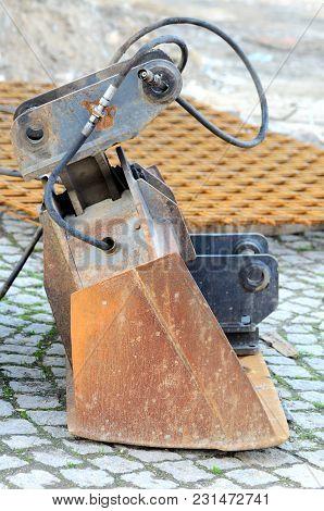 Close Up Of Old Rusty Excavator Bucket Scooping