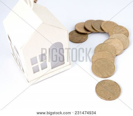 Mini House On Stack Of Coins. Concept Of Investment Property. Housing On Credit.