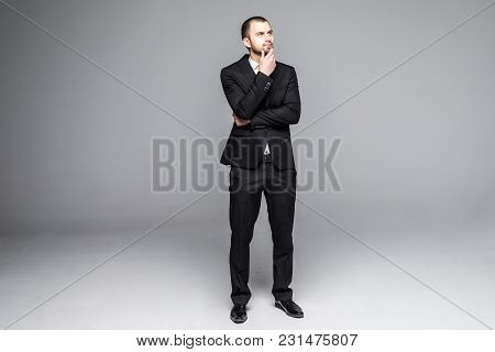 Thoughtful Young Business Man Looking Isolated On White