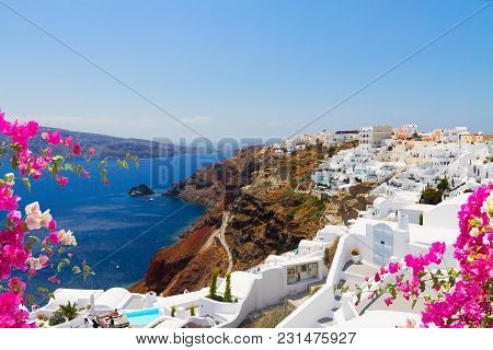 Oia, Traditional Greek Village With Flowers And Aegan Sea Waters, Santorini, Greece