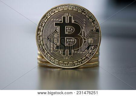 Golden Bitcoin Facing The Camera In Sharp Focus, Close-up. Virtual Anonymous Money  Concept.