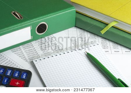 Calculator, Accounting Books And Pen On Background Of Financial Document. Financial And Budget Conce