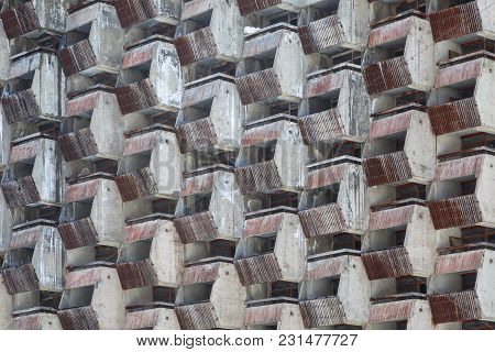 Lattice Dilapidated Balconies Of The Standard Rooms Of The Old Unfinished Hotel As Background Or Bac