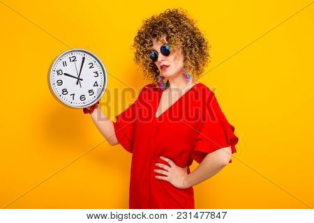 Portrait Of A White Woman With Afrro Curly Hairstyle In Red Dress And Sunglasses Holding Watches Wit