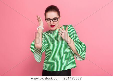 Portrait Of Attractive Cheerful Businesswoman With Hair Bun In Striped Blouse And Eyeglasses With Dr