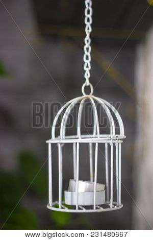 Candlestick With Candle, Cage Style, Valentine's Day Decor. On Dark Interior Background.
