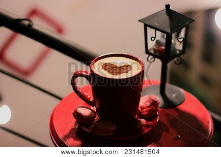 Cup Of Brewed Coffee With Painted Heart, A Branch Of Spruce, Candles And Lantern
