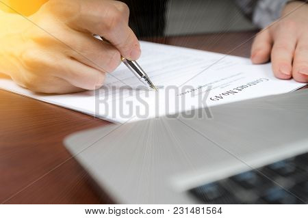 A Businessman Puts His Signature On The Contract.