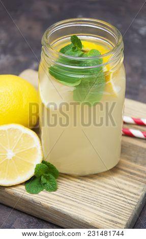 Homemade Lemonade With Fresh Lemon And Mint On A Stone Background