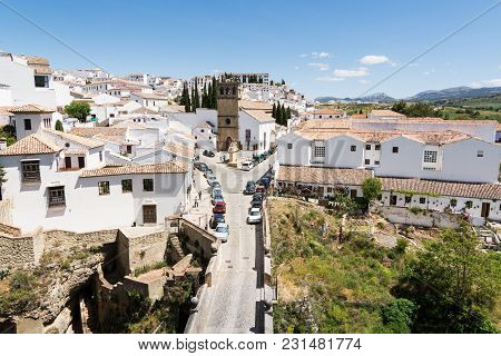 Ronda, Spain - May 2017: View Over Ronda Old Town And Viejo Bridge, Overlooking The White Houses And
