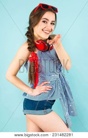 Close Up Portrait Of Brunette Cheerful Young Woman Dj With In Striped Shirt And Sunglasses On Blue B
