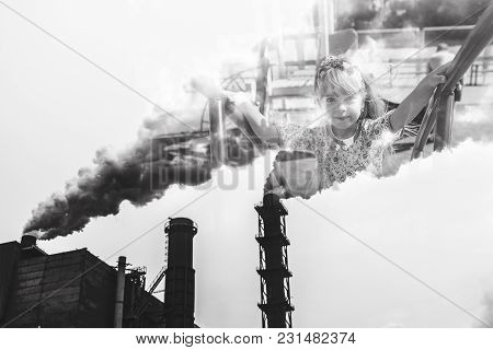 Mining Enterprise With Smoke Stacks. Dirty Smoke On The Sky, Ecology Problems. The Concept Is Pollut