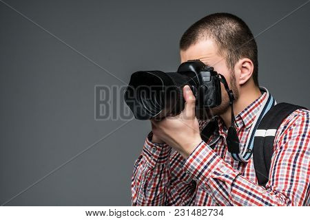 Close Up Portrait Of Photographer Taking Pictures With Digital Camera