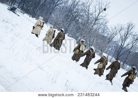 Detachment Of Soldiers Dressed In The Form Of The Second World War Are Walking Along The Snow Covere