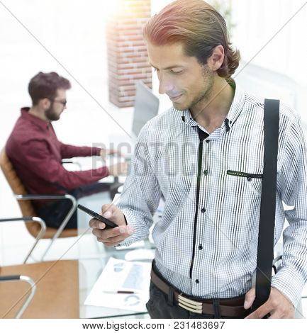 employee reads a text message on smartphone