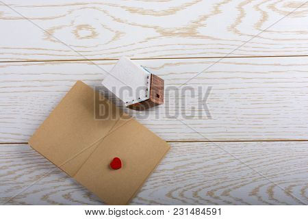 Little Model House  And A Notebook On A Parquet Background