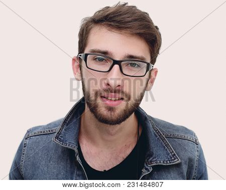 portrait of a modern young man in spectacles
