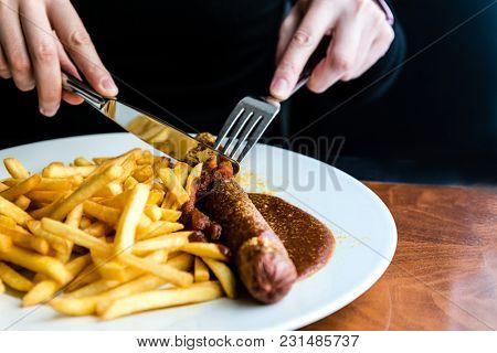Tasty german sausage served with sauce