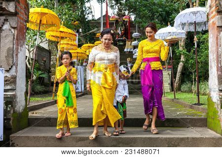 Ubud, Indonesia - March 2: Balinese Family In Traditional Clothes During The Celebration Before Nyep