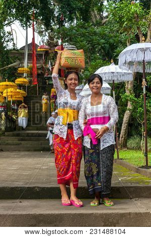 Ubud, Indonesia - March 2: Young Woman With Her Mother In Traditional Clothes During The Celebration