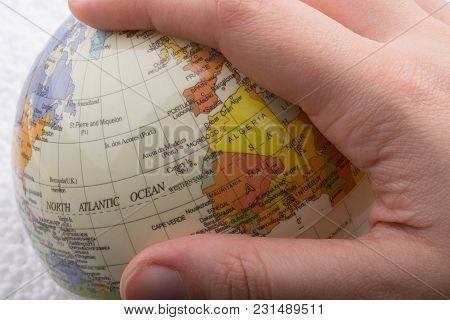Hand Holding A Globe  With Map On It
