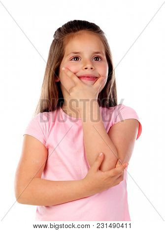Pensive small girl imagining something isolated on a white background