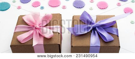 Banner Two Gift Boxes On Festive Background Of Pastel Confetti. Flat Top View