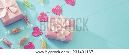 Banner Decorative Festive Background With Gift Boxes. Textured Blue Candy Background. Flat Lay Top V