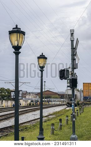 New Orleans, Usa - Aug 20, 2017: Lamp Posts And Signal Boxes Along Railway Track Near Dumaine Street